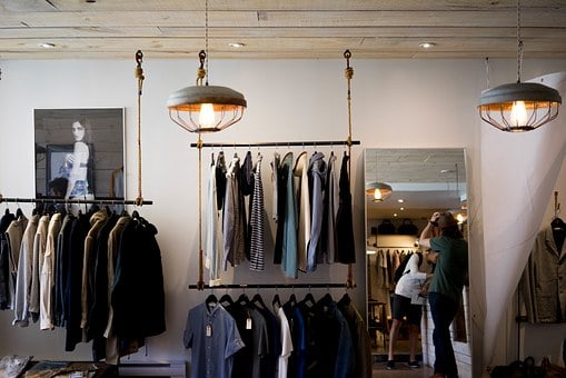 Mens wardrobe with suits and shoes