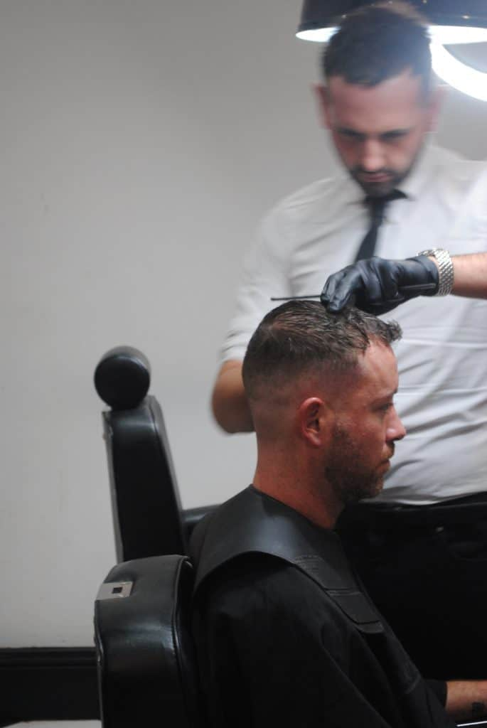 How much should I tip my barber