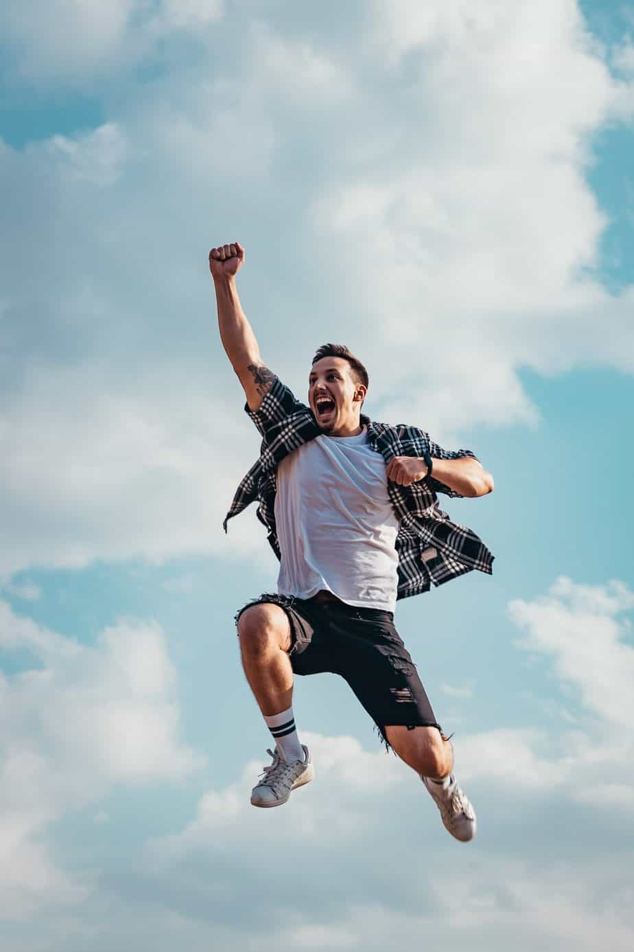 Man jumping for joy smelling clean and fresh
