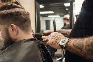 Barber using hair clippers