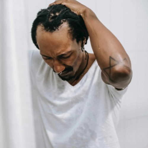 black man with thinning hair